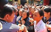 Hình ảnh xúc động tại Lễ tang phóng viên TTXVN Đinh Hữu Dư