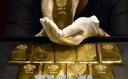 Giá vàng thế giới tăng nhẹ, chứng khoán Mỹ đồng loạt giảm điểm