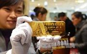 Giá vàng phục hồi trước thông tin Mỹ-Trung nối lại đàm phán