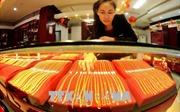 Giá vàng châu Á chạm mức thấp nhất trong 18 tháng